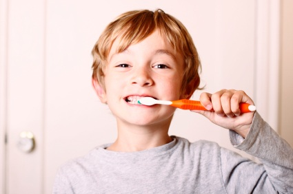 Schererville, IN boy brushing his teeth before visiting the dentist.